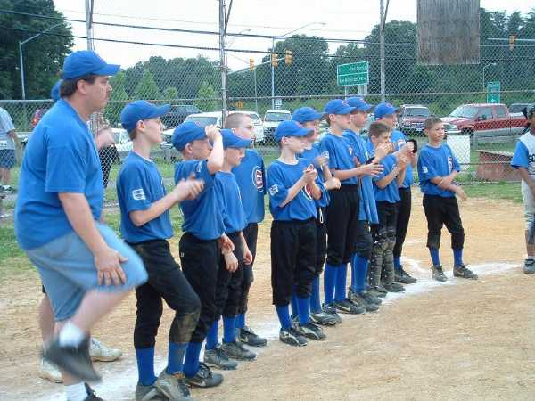 2003.  The 12U Cubs were undefeated in the regular season, and then went on to win the Love To Play Regional Championship.  They are shown here lining up to receive their championship medals.  The Cubs went on to compete in Pennsylvania at the LTP World Series.