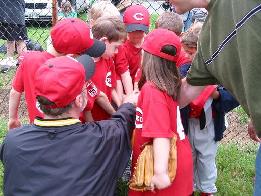 2003. Manager Mike Spratley leads the JCP Reds in a post-game cheer.