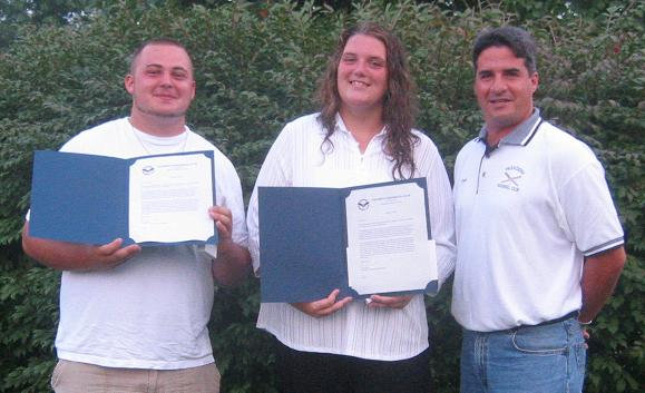 2004.  Scholarship winners Tommy Henry and Sherri Hayes with President Fred Engel.