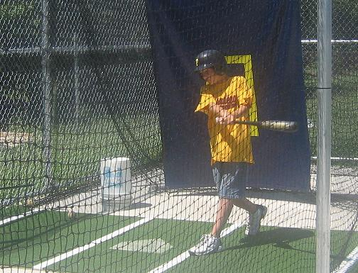 2006.  Robert Engel takes a cut in the Havenwood Park batting cage after the permanent machine was installed.