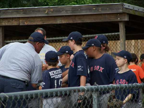 2009. Manager Steve Williams calls his Red Sox players in for a pep talk during their win over the Orioles in the 10U World Series Championship game.