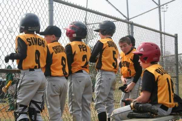 2009. The 11U Eagles look on from their bench.