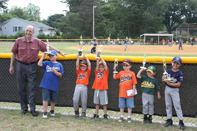 2011.  County Executive stands with the Clinic Home Run Derby winners at Closing Day.