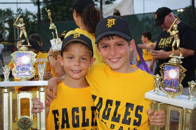 2013.  Colin Cook and Trevor Rebstock show off their hardware after winning the LFYAA tournament as part of the 10U All-Star team.