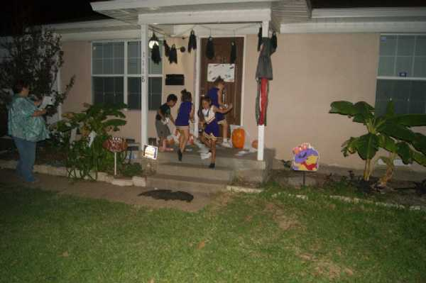 The girls putting the poster board on the front door. Homecoming 2011