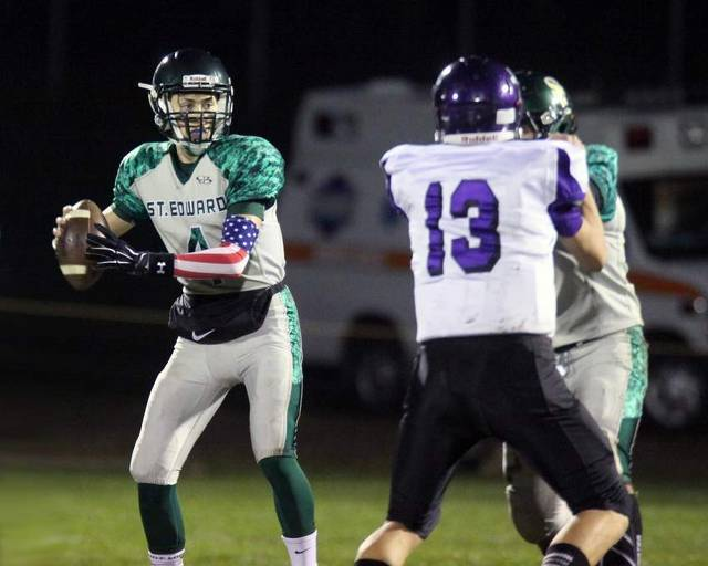 b4917f0e8d3 St. Edward quarterback Joe Mullen and his receiving corps lit up the Friday  night sky in Elgin.