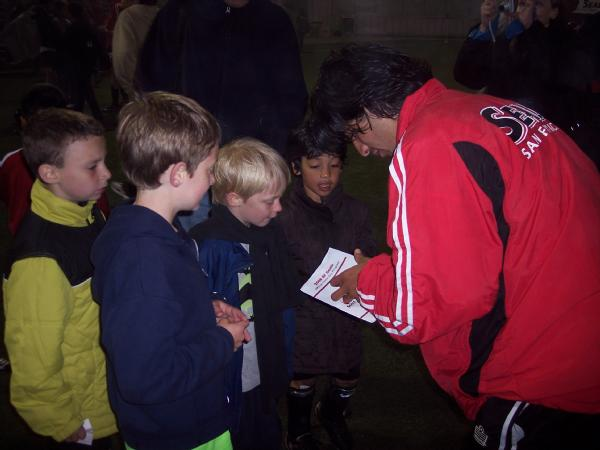 Shea Whealan signs autographs at the end of the match.