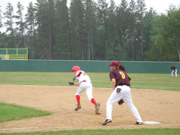 Gnats first baseman Stephen Funk holds the bag as the Wolf Lake runner breaks for 2nd.