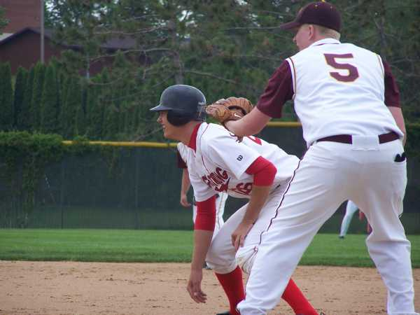 Jake Sumner holds on the baserunner in a game at Brainerd.