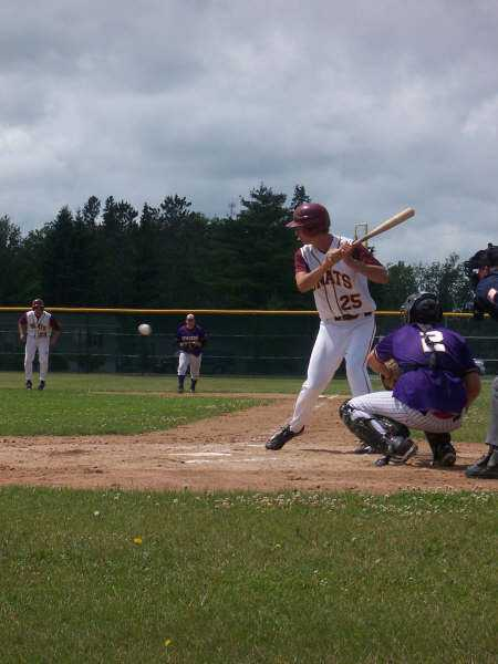 Alex Brockpahler takes an inside pitch against Sebeka while Ben Bestland follows the pitch into the zone on first.