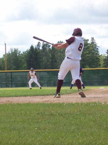 Travis Titcomb puts a charge into a pitch against the Stingers with Tyler Brockpahler on the base.