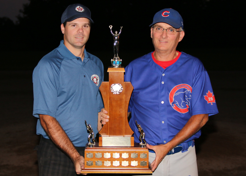North Dufferin Baseball League secretary and junior division convenor Scott Anderson presents the Anderson Trophy to coach Dave Metz of the Mansfield Cubs during a post-game presentation Aug. 23.