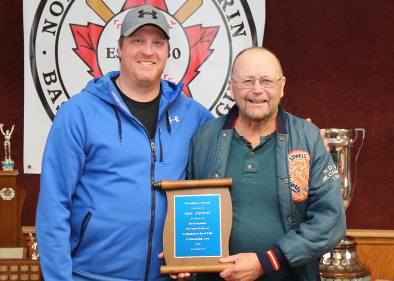 North Dufferin Baseball League president Jesse McIntyre presents Bill Patton a President's Award for his dedication and support to the league on Mar. 10. Patton was instrumental in developing a junior division in 1983 and served in various executive positions.