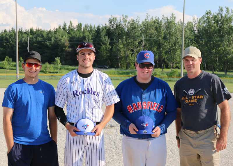 Junior Division Game Most Valuable Players<br /> Orangeville Giants Nick Hodgson (left) and league secretary Scott Anderson (right) congratulate and present ball caps donated by TLR Productions to Nick Reid for the Bandits and Zaacary Helmer for the Royals as the as the most valuable players of the game.  Reid went three for five, including two triples, scored two runs and one RBI.  Helmer went two for four including a homerun and two RBI.