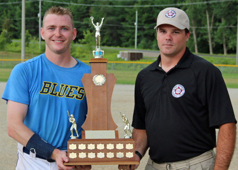 Ryan Barr of the Ivy Blues receives the Anderson Trophy from North Dufferin Baseball League secretary and junior division convenor Scott Anderson after Ivy won the junior championship on Aug. 18, 2019. The Blues defeated the Orangeville Rockies 8-4 in the final game.
