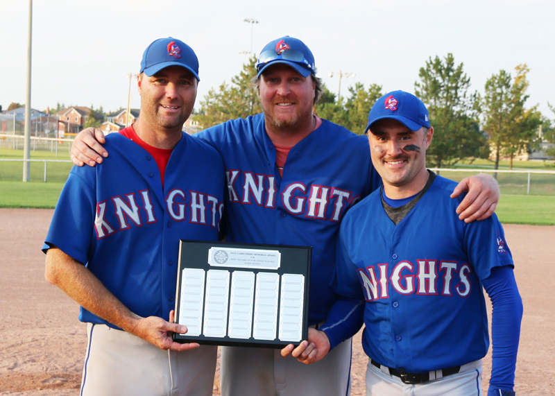 North Dufferin Baseball League past president Jesse McIntyre (centre) presents the Paul Carruthers Memorial Award for the most valuable player during the playoffs to Todd Patton and Brandon Norrie during a post game presentation Sept. 21, 2019.