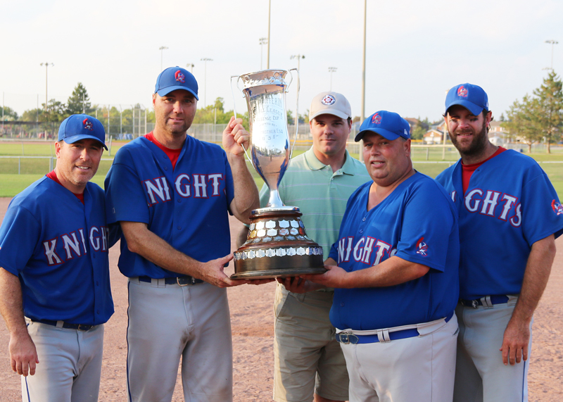 North Dufferin Baseball League secretary Scott Anderson (third from left) presents the Strother Cup as league champions to Steve Baldry, Todd Patton, Peter Kinghan and Sean Connor of the New Lowell Knights during a post game presentation Sept. 21, 2019.