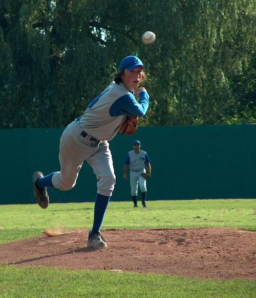 Mike Rochon #14 delivering a pitch off the mound in Peterborough.   Reports indicate that the pitch curved right back to Mikey, but not before going through a Wendy's drive thru and bringing back a small chilli to the awaiting pitcher.