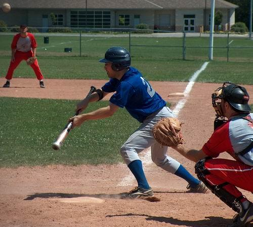 Evan DePiero #28 bunting down the line in Port Hope. Using GPS technology, he was able to track his speed to first base and also determine the distance from first base to the closest Linen and Things.