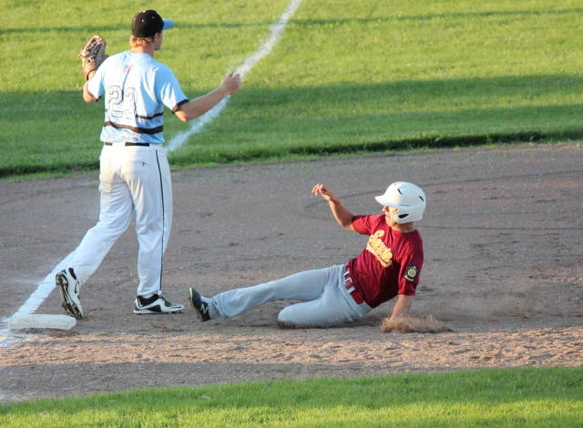 Connor Berg slides into third