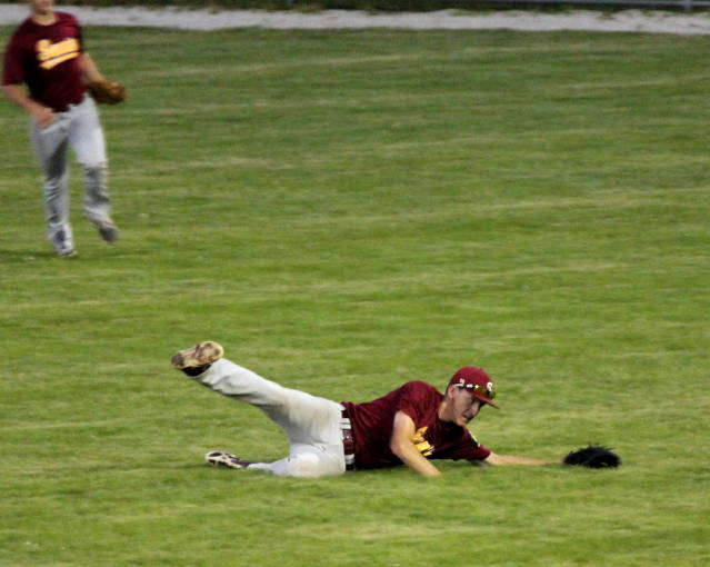 Noah Oswald makes a sliding catch in right