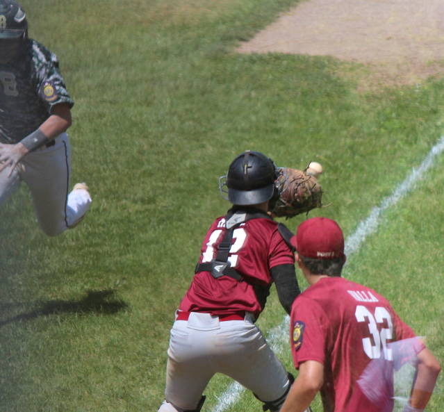 Nolan McGill tries to get the out at home