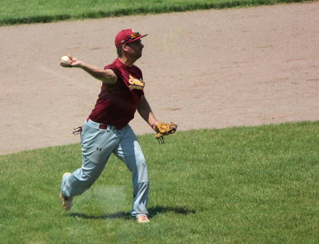 Jake Tyrakoski throws to first