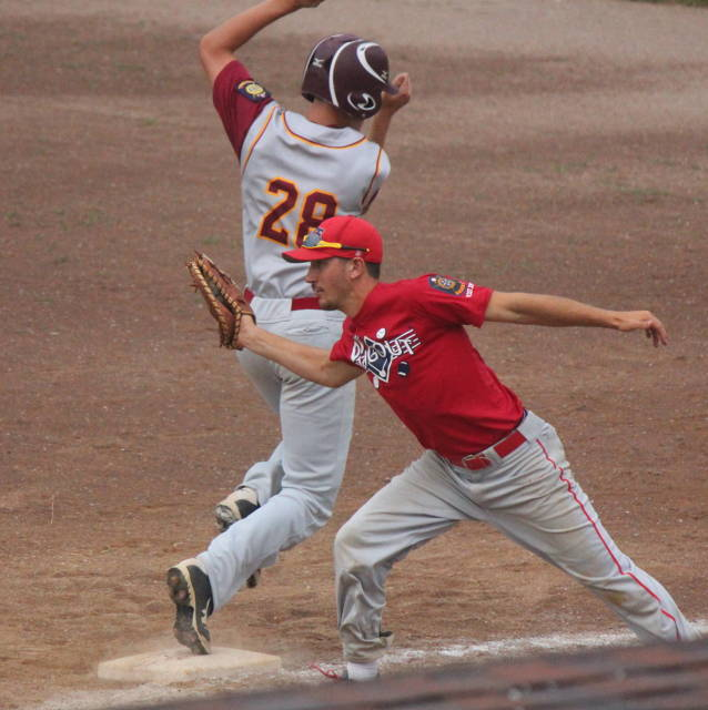 Noah Oswald dodges the tag at first