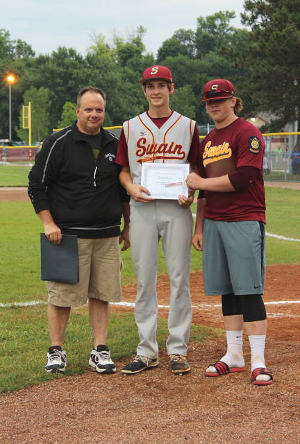 Joe and Tommy Alitz present Nick Iossi with the Tyler Alitz Memorial Scholarship