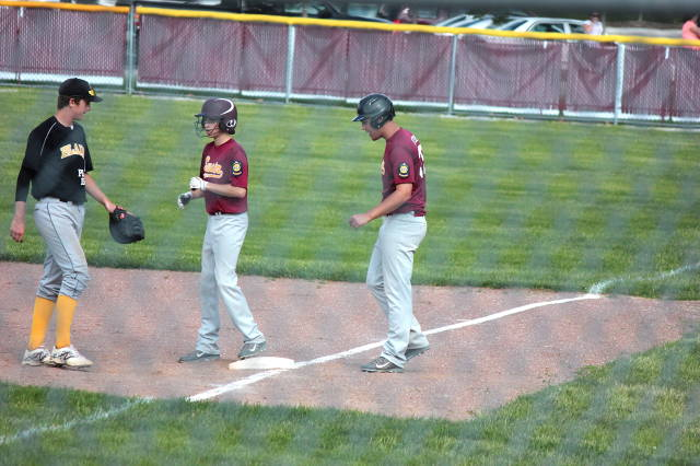 Dan Bowers coaches first base