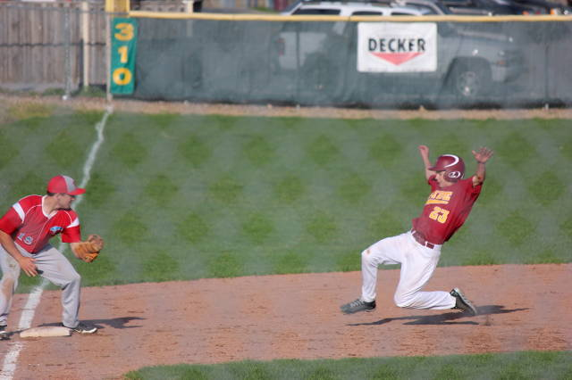 Nolan Chaloupka begins the slide into third