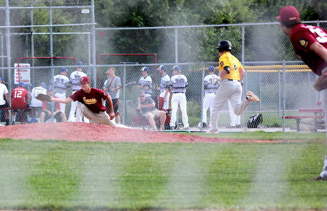 Connor Miller stretches to make the play at first
