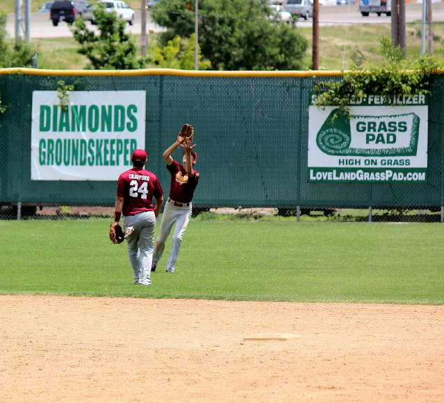 The ball is caught by left-fielder Nick Iossi