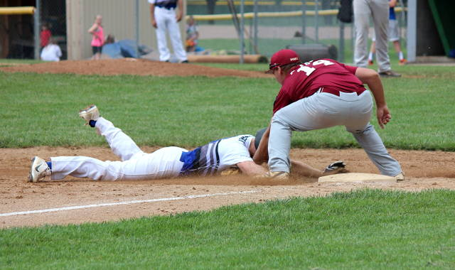 Jake Tyrakoski makes the tag at third