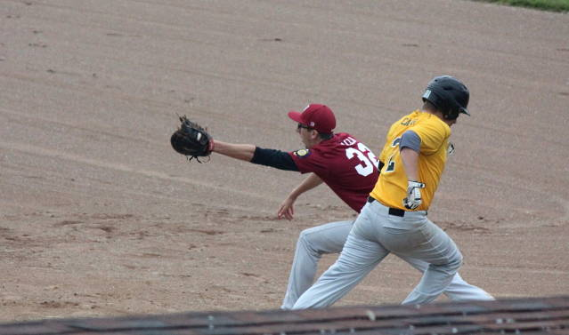 Nick Valla stretches to make the out at first
