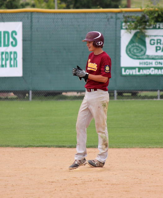 Nolan Chaloupka at second after his 3-run hit
