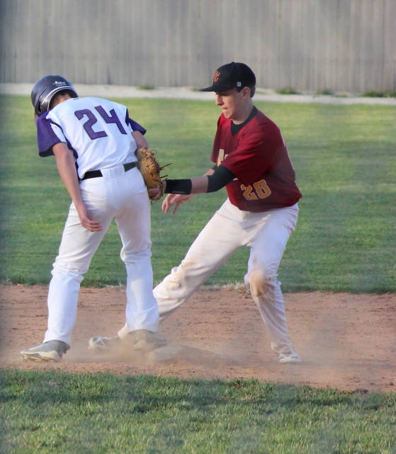 Noah Oswald tries to tag runner