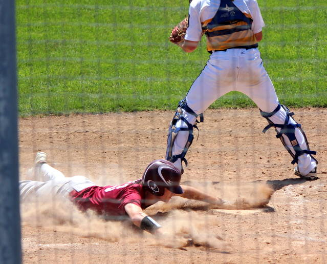 Nick Iossi slides across home plate