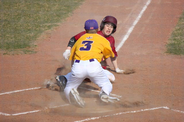 Ty Kloewer slides into home