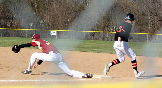 Nick Valla stretches to get the out at first