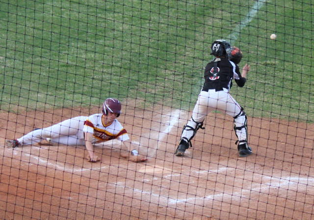 Zach Wiese slides into home to beat the throw