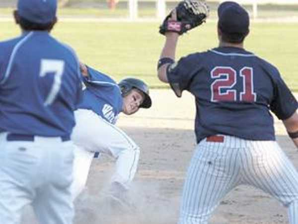 Watertown's Brandon Egnarski gets hung up between first and second base while Prepside first baseman Brandon Hildebrant takes the throw during American Legion action Wednesday at Washington Park. Watertown won 5-3. 