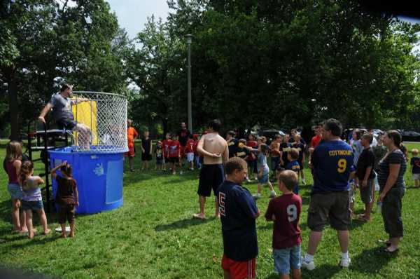Everyone lines up to dunk the league President.