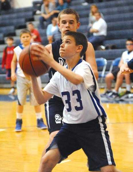 West Fairmont Middle School's Robbie Potesta (33) goes up for a shot during the recent East Fairmont Shootout