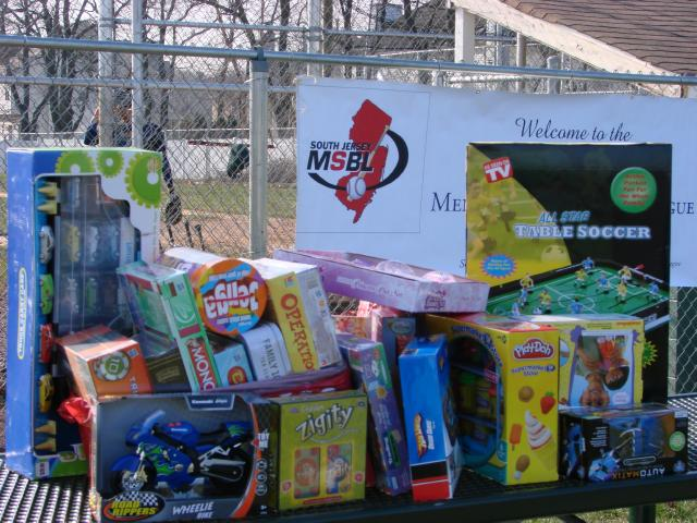 One of the stacks of donated toys collected at Winterball 2010