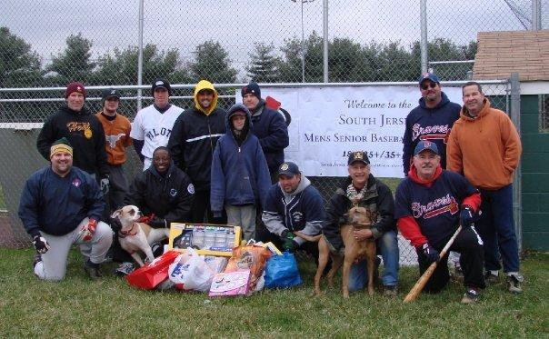 Some of the sjmsbl players who participated in winterball 2008 posing with a portion of the donated toys.