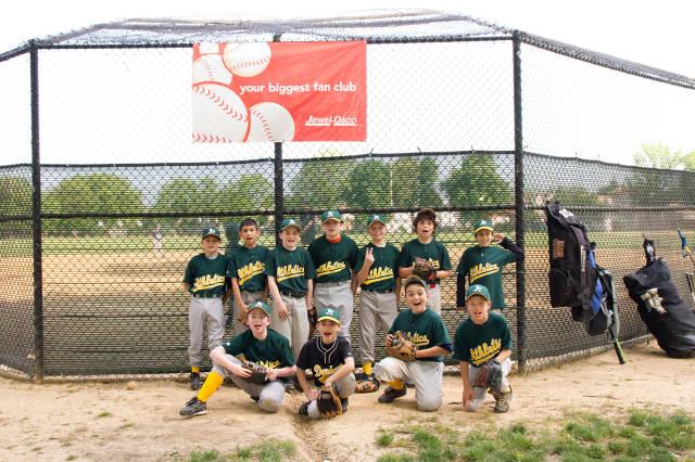 happy kids playing baseball