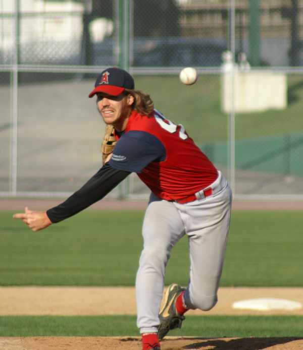 Justin dominating on the mound - this photo should be a baseball card!.....