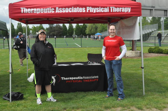 Amy Tanous and her associate work the sponsor booth for Theraputic Associates.  TAI has partnered with TVLAX in a generous sponsorship of both the Oregon Cup and the End of Season Jam.  Players were treated to TAI sunglasses and chapstick!