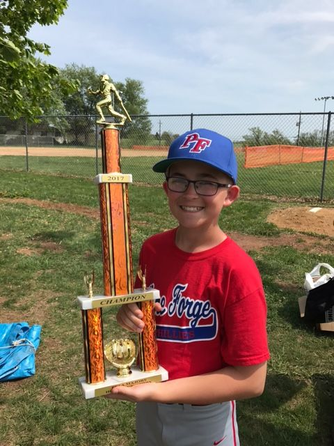 Tyler posing with his Home Run Derby Trophy